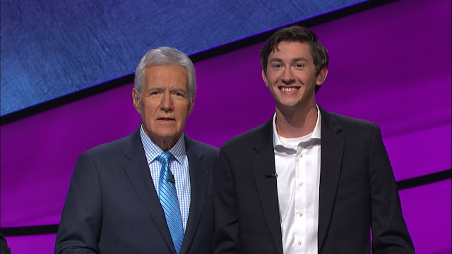 Photo of Alum with Jeopardy Host