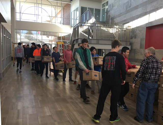 Photo of Students hauling books to New Building