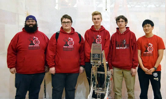 Team poses for photo with Robot at State Championship