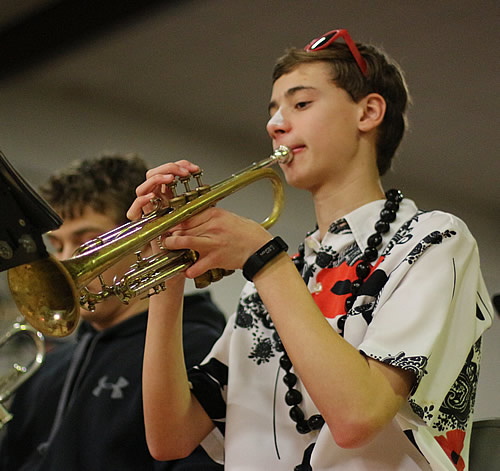 Student plays trumpet in the pep band