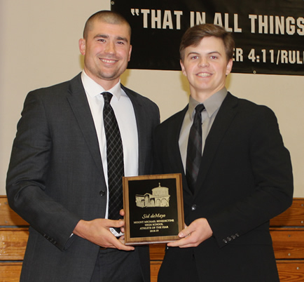 Photo of Coach Spooner presenting Athlete of the Year award to Sid deMayo