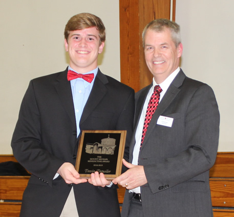 Dr. Peters presents Trevin Detwiler with the Mount Michael Award