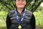 Luke Poses with his Championship Medal