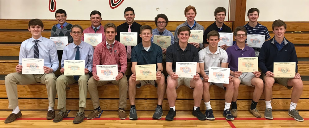 A partial group of recipients pose in the bleachers with their certificates.